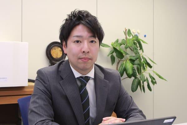 新社屋プロジェクト室の志賀さんの画像